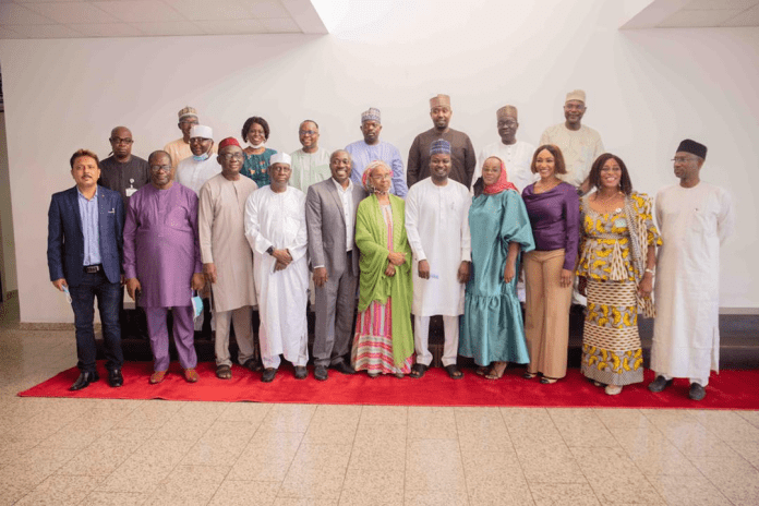 Chairman, Cosgrove Investment Limited, Umar Abdullahi (5th From Left), and the Ag Executive Secretary, Federal Capital Development Authority (FCDA), Hajiya Zaliha'u Ahmed and other management staff of Cosgrove and FCDA, shortly after Cosgrove handed-over the newly renovated 188-seater conference hall to the Authority, at the FCDA Headquarters, recently, in Abuja. PHOTOCREDIT: Cosgrove Media.
