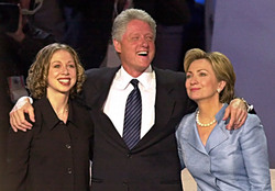 President Bill Clinton stands smiling with his arms around First Lady Hillary Rodham Clinton and daughter Chelsea after addressing the Democratic National Convention at the Staples Convention Center in Los Angeles, California on August 14, 2000. Photographer:Tannen Maury. Bloomberg News.