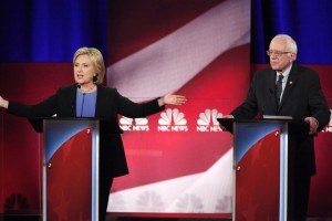 Democratic U.S. presidential candidate and former Secretary of State Hillary Clinton (L) speaks while rival candidate U.S. Senator Bernie Sanders (R) listens at the NBC News - YouTube Democratic presidential candidates debate in Charleston, South Carolina January 17, 2016. REUTERS/Randall Hill - RTX22TGY