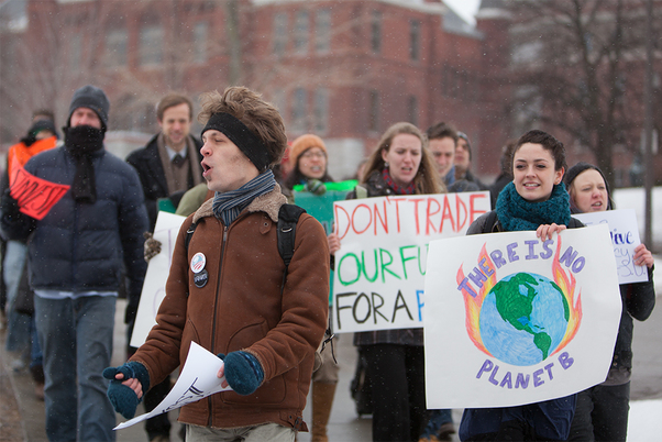 Students who are a part of the Fossil Fuel Divestment Campaign chant as they march from the steps of Hendricks Chapel to Crouse Hinds Hall. The group was advocating for the university to stop investing in fossil fuels. Students also discussed the issue with administrators.