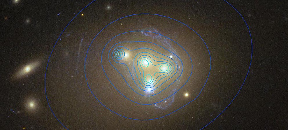 C'est dans l'amas de galaxies Abell 3827 que les contours de la matière noire ont pu être détectés par les astronomes européens de l'ESO.