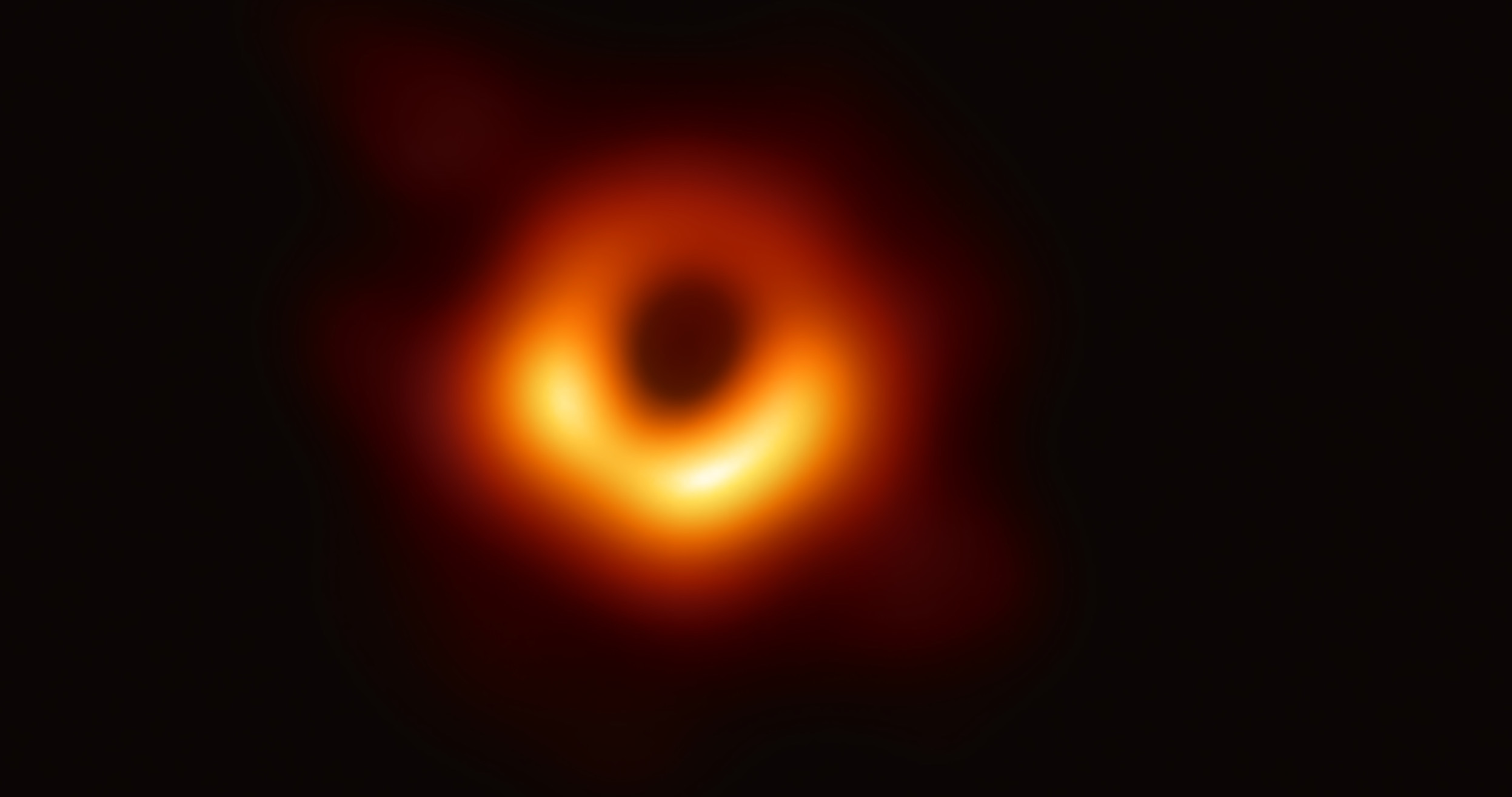 Première image d'un trou noir. © EHT collaboration