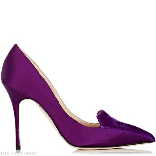 Manolo Blahnik purple satin Elatiamod pumps styled with a suede vamp.