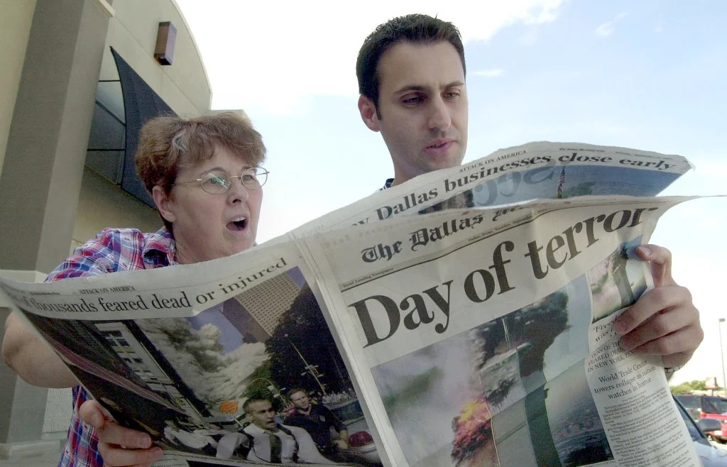 Jeanie Quest and Phillip Jabour read a special edition of the Dallas Morning News in Dallas, Texas September 11, 2001. (Photo: UPI Photo Service/Ian Halperin/Newscom)
