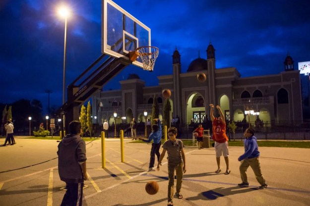 Children play basketball before the evening prayer at the The Maryam Islamic Center in Sugar Land, Texas. (Photo: Scott Dalton)