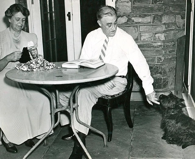 Former President Franklin D. Roosevelt and his wife Eleanor with their Scotch terrier Fala on the terrace of his house in Hyde Park, New York. (Photo: Newscom)