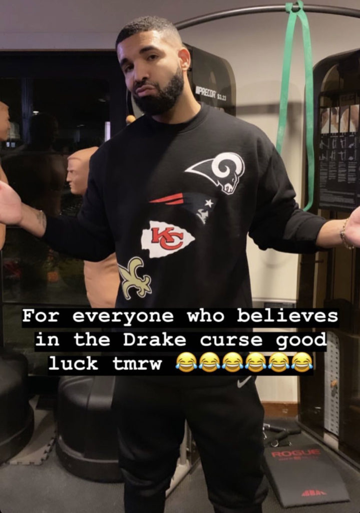Drake Curses Every NFL Team Playing Today By Wearing Shirt Supporting All Four Teams At Same Time
