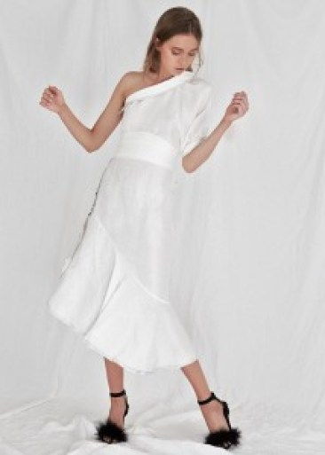 model with long white one shoulder dress