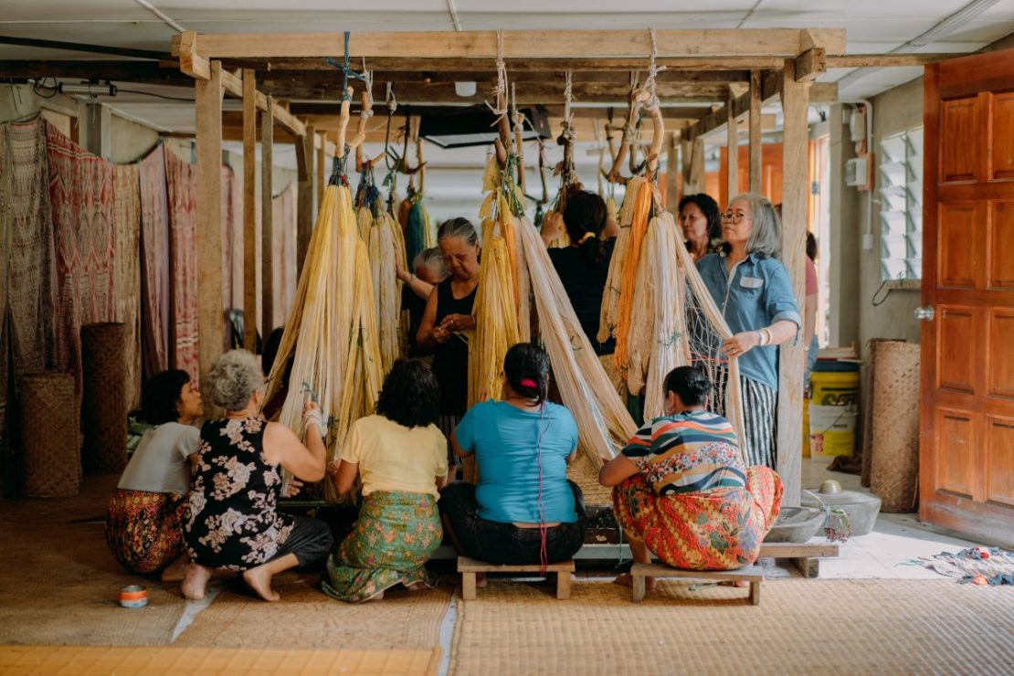 Weavers of Rumah Gare preparing their threads for the Ngar ritual where they mordant their threads before weaving. Image Supplied.