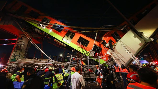 23 dead in overpass collapse, search underway