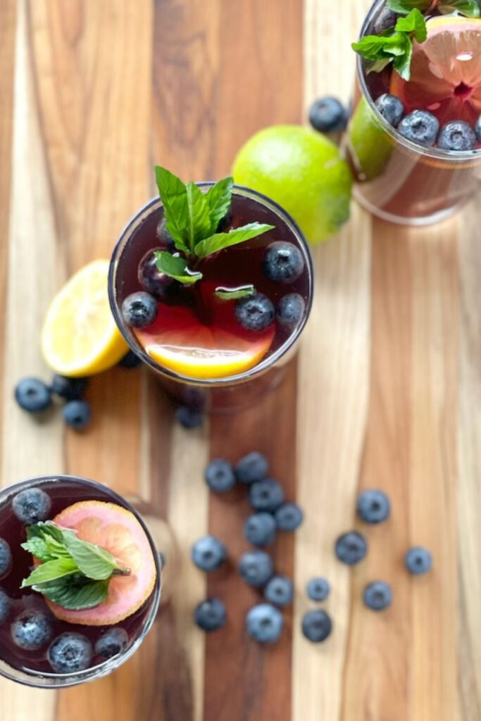 fruity iced tea with blueberries, mint, and lemon