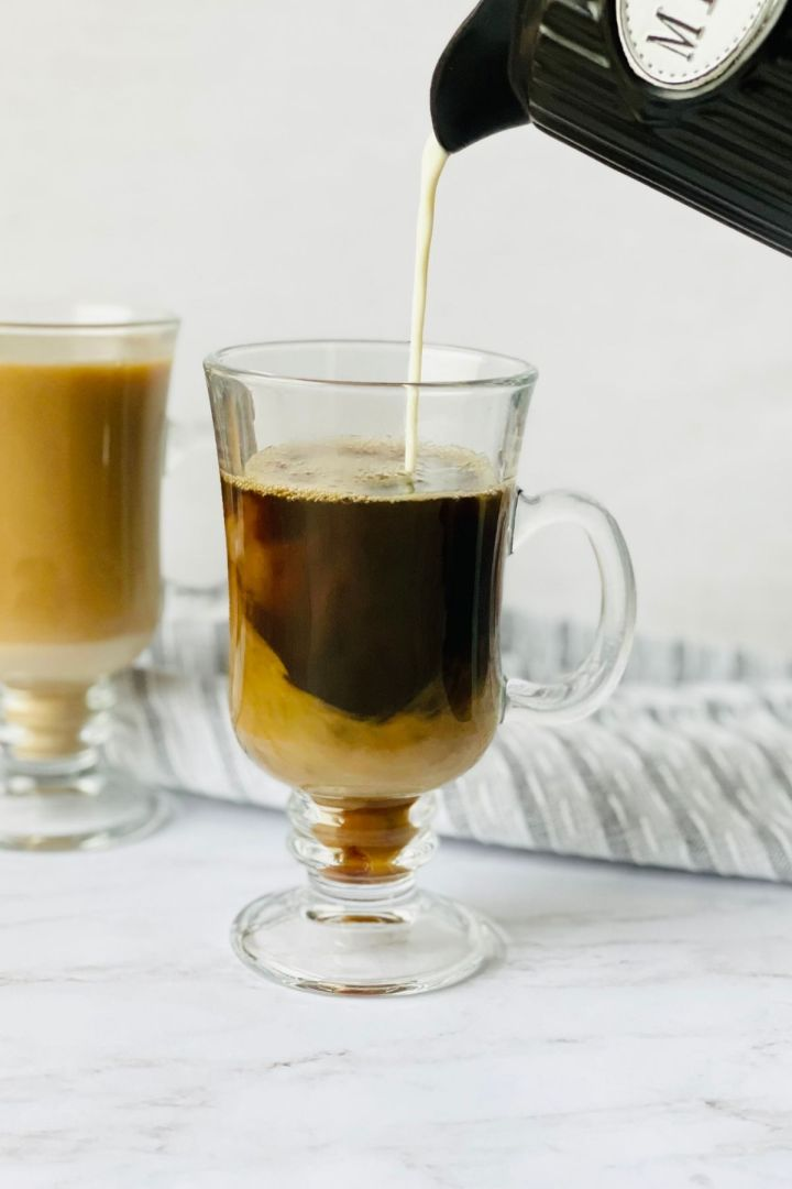 brown sugar milk tea with pitcher of milk pouring into cup