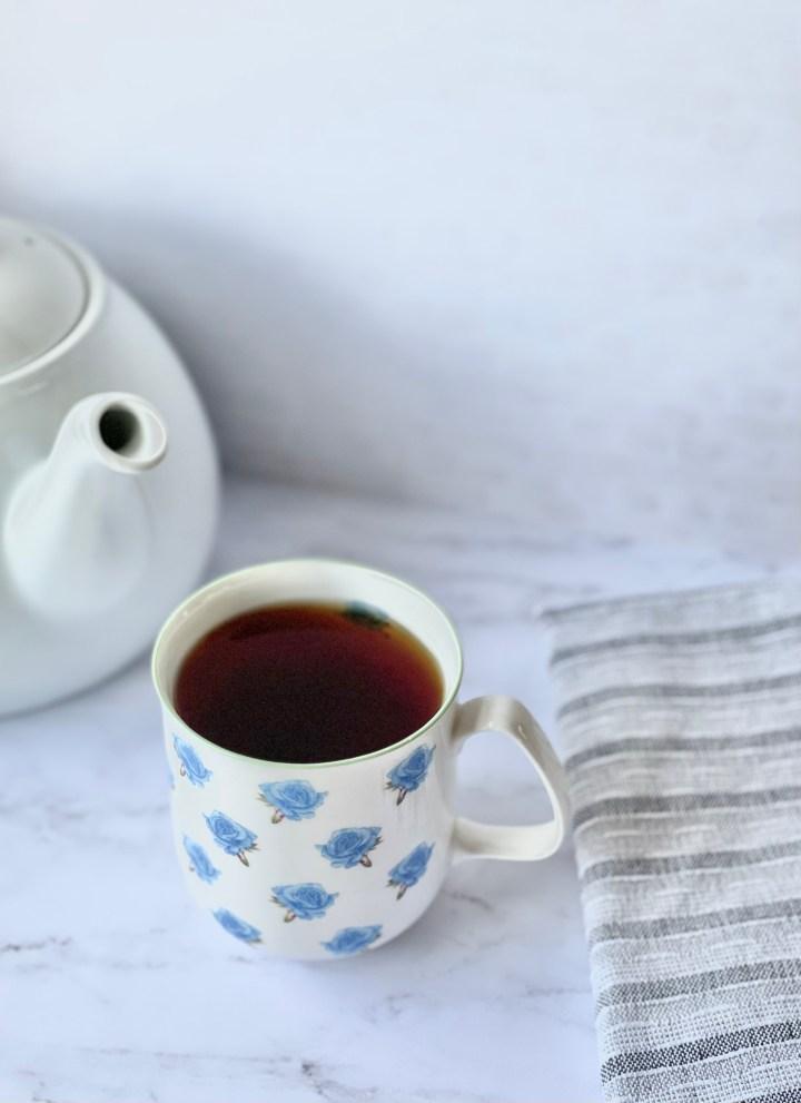 english breakfast tea in teacup with teapot