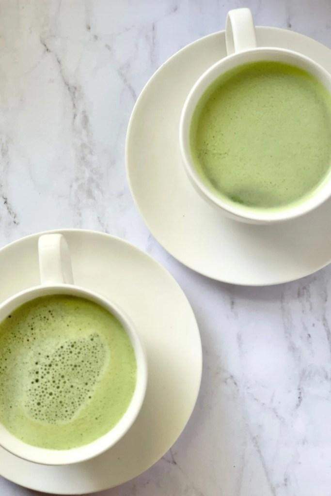 two tea cups of matcha latte