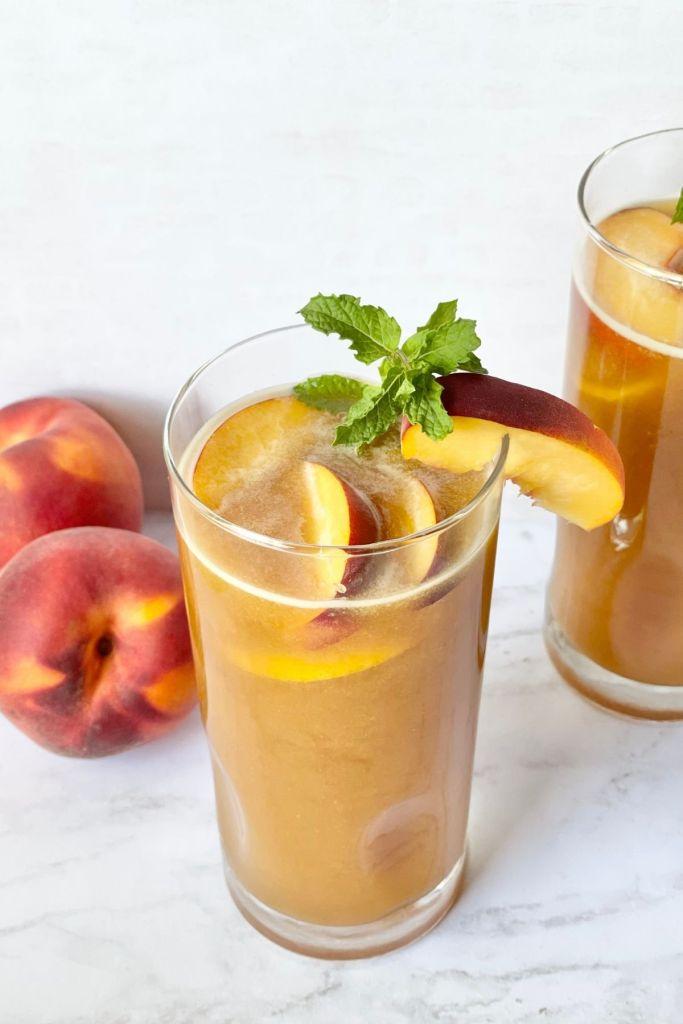 peach iced tea with fresh peaches and mint