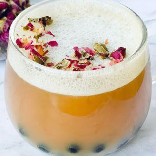 rose milk tea with boba and rose petals