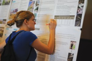 Cartographer · Sarah Stoker, a community member, writes her  comments on a map of the area at a city planning community workshop. - Eric Burse | Daily Trojan