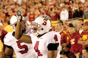Unwelcome guests · Mark Bradford (4) and Anthony Kimble celebrate Stanford's shocking 24-23 win over USC in the Coliseum in 2007. Bradford caught a last-minute touchdown from Tivita Pritchard to break USC's 35-home game winning streak. - Joel Zink | Daily Trojan