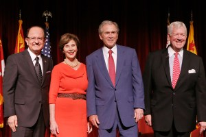 Nation's 43rd · USC President C. L. Max Nikias poses with former president George W. Bush and Laura Bush at Bovard Auditorium. - Photo courtesy of Steve Cohn