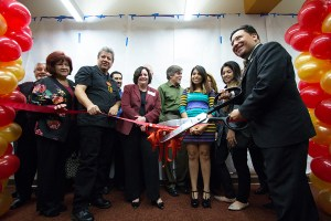 Chop, chop · Bill Vela, director of El Centro Chicano, cuts the ribbon at the grand opening of El Centro's new location in the Gwynn Wilson Student Union. Students, faculty and alumni attended the event.  - Nick Entin   Daily Trojan