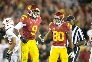 Tough going · Junior wide receiver Marqise Lee (9) cringes in pain during USC's win over Stanford. Despite the injury, Lee finished the game with six receptions for 83 yards, including a crucial 13-yard fourth down conversion. - Ralf Cheung | Daily Trojan