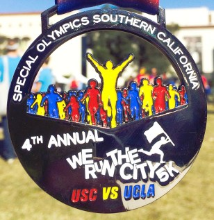 Crosstown showdown · More than 2,000 runners participated in the We Run the City 5K, which took place Sunday in Exposition Park.  - Photo courtesy of Stephanie Hernández