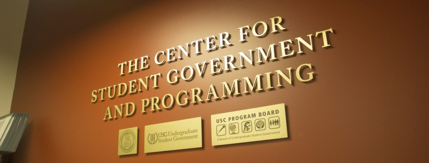 "Against a brown wall are the words ""The Center for Student Government and Programming."""