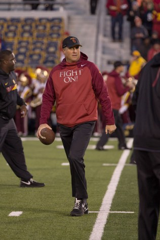 Nick Entin | Daily Trojan Rags to roses · First year head coach Clay Helton finds himself looking to restore glory to a once-prominent USC football program.