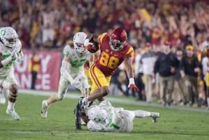 Daniel Imatorbhebhe pulls down a catch from Sam Darnold - Trevor Sochocki | Daily Trojan