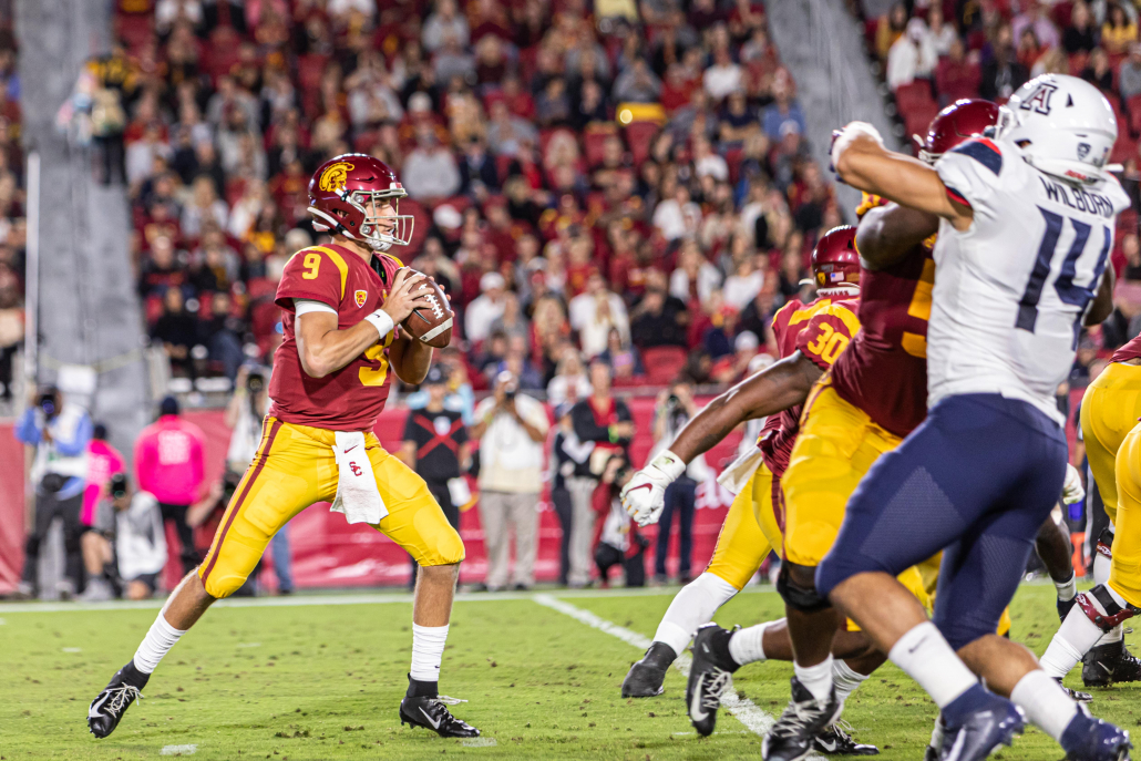 Sophomore quarterback Kedon Slovis drops back to throw a pass against Arizona in a game in fall 2019.