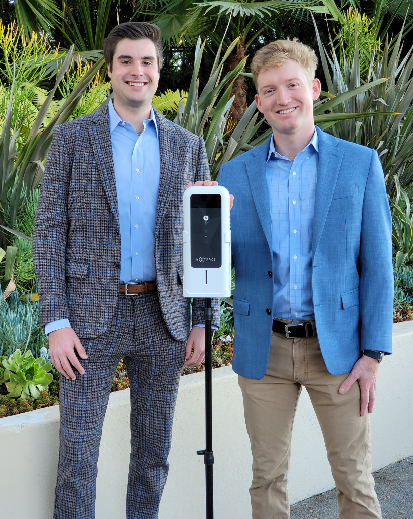 Troy Bonde and Winston Alfieri stand next to their thermo-sanitizer device.