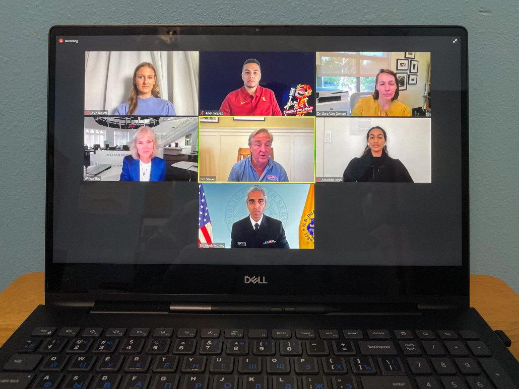A photo of a laptop displaying seven people on a Zoom call.