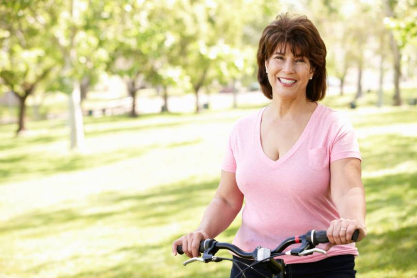 hispanic woman riding bicycle