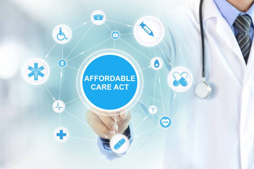 Doctor hand touching AFFORDABLE CARE ACT sign on virtual screen