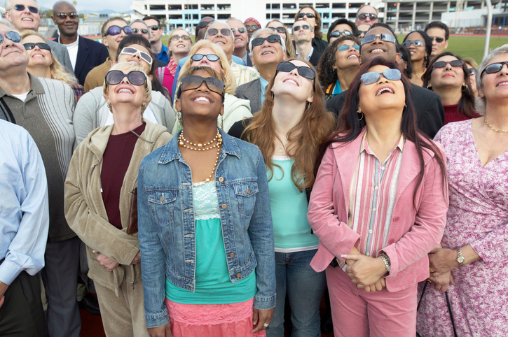 crowd watching an eclipse