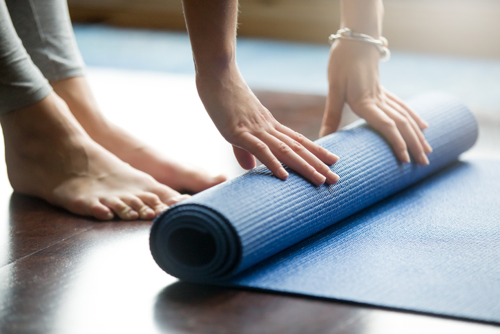 woman doing yoga, yoga mat