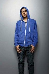 Depressed teen standing in a blue hoodie