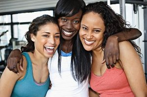 Three young women smile