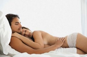 Naked couple sleeps in bed