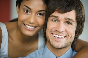A man and a woman smile at the camera