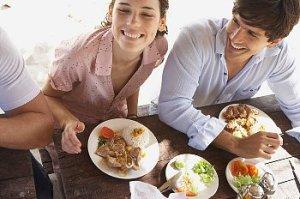 A couple eats outdoors