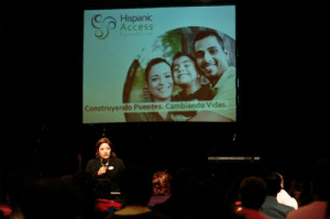 Maite Arce, president of Hispanic Access Foundation addresses the crowd at a recent tax education workshop in Dallas