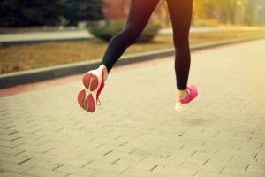 runner,woman running, woman in leggings running, back of shoes