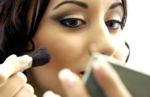 Makeup, hispanic woman applying makeup