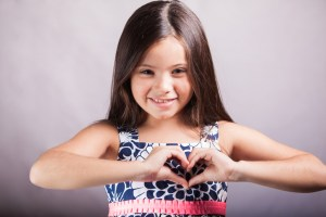 girl with heart sign