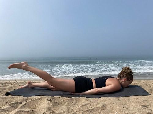 Ardha Salabhasana - half locust pose - yoga pose girl sunny day yoga on the beach