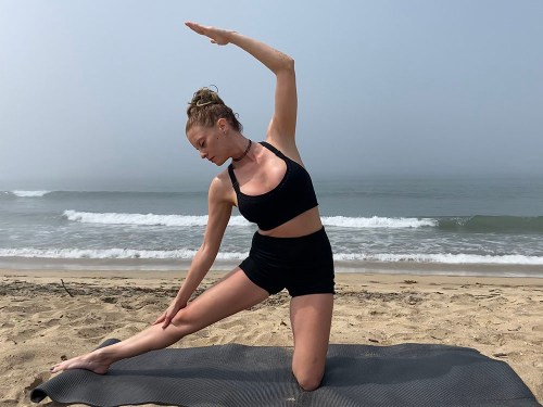 Parighasana - gate pose - yoga pose girl sunny day yoga on the beach