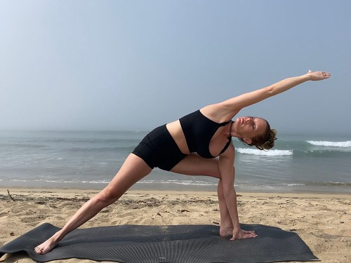 Utthita Parsvakonasana - extended side angle pose - yoga pose girl sunny day yoga on the beach