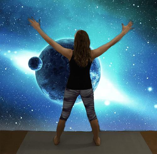 Utthita Tadasana - five-pointed star pose variation hands raised - yoga pose girl blue planet galaxy background