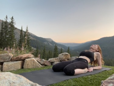 Ardha Supta Virasana - Half Reclined Hero Pose - yoga pose yoga girl wearing black doing yoga outside in the rocky mountains